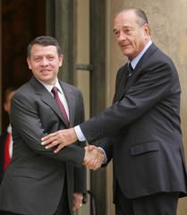 French President Chirac greets King Abdullah II of Jordan at Elysee Palace.