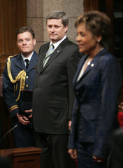 Canada's PM Harper looks at Governor General Jean during a ceremony on Parliament Hill in Ottawa