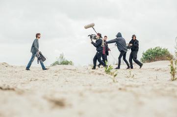 Behind the scene. Film crew filming movie scene outdoor