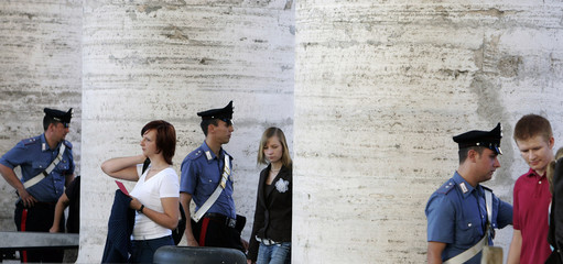 Police check tourists at the entrance to Saint Peter's Square before Pope Benedict's general audience at the Vatican