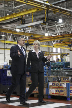 Britain's Prime Minister Gordon Brown walks with Managing Director Angela Paver during his tour of Leyland Trucks in Leyland