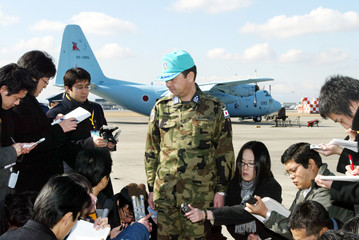 JAPANESE AIR SELF-DEFENSE FORCE COLONEL SPEAKS TO REPORTERS AT KOMAKI AIR BASE, CENTRAL JAPAN.