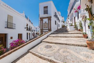 Charming narrow historic streets of white village Frigiliana.