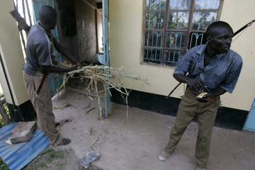 Members of Kalenjin tribe set fire to a building in the town of Chepilat