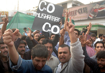 Human rights activists chant anti-government slogans during a protest against emergency rule in Islamabad