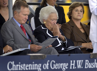Former U.S. President George H.W. Bush, his wife Barbara Bush and their daughter Doro Bush Koch listen to speakers during ceremony to christen the U.S. Navy aircraft carrier George H.W. Bush in Newport News, Virginia