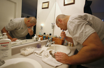 Iraq war veteran Ken Sargent brushes his teeth at home March 14, 2007