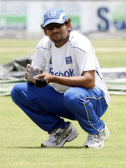 Sri Lanka's Dilshan squats during practice session ahead of first test cricket match against NZ in Galle