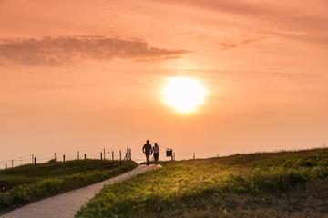 Couple walking together at sunset, Helgoland island
