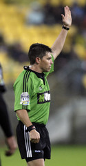 Referee Paul Marks raises his hand during the game between the Hurricanes and the Sharks in their Super 14 rugby match in Wellington