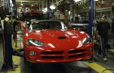 A Chrysler auto assembly worker walks past a 2008 Dodge Viper on the assembly line of the Chrysler Conner Avenue Assembly plant  Detroit