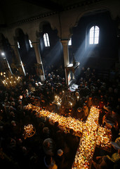 Worshippers gather around candles in the church of the Presentation of the Blessed Virgin in Blagoevgrad