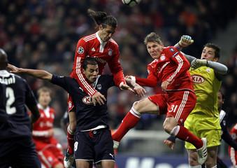 Bayern Munich's Martin Demichelis and Bastian Schweinsteiger challenge goalkeeper Cedric Carrasso of Girondins Bordeaux during their Champions League soccer match in Munich