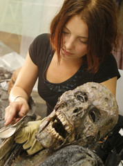 Makeup artist Emmi Leeve works on a prop on the set of the horror movie 'Dark Floors' in Oulu