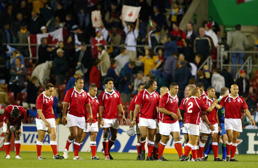MEMBERS OF THE TONGAN TEAM WALK OFF THE FIELED AFTER LOSING THEIR WORLDCUP MATCH AGAINST CANADA ...