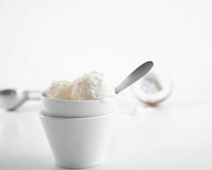 Fresh coconut ice cream on white background