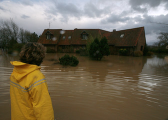 A resident looks at her house flooded in the northern French town of Polincove