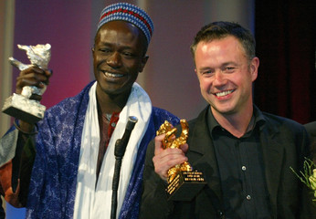 BRITISH DIRECTOR WINTERBOTTOM AND SENEGALESE DIRECTOR SENE ABSA POSEWITH AWARDS AT BERLINALE IN BERLIN.