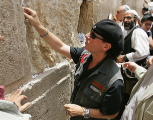 "Lead singer of German rock band ""the Scorpions"" Meine places a note in the Western Wall in Jerusalem."