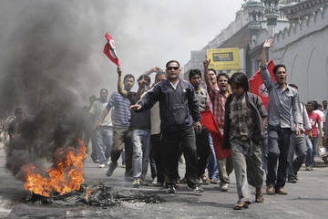 Students affiliated with Nepal Congress shout slogans against Maoist Prime Minister Pushpa Kamal Dahal who sacked army chief General Rookmangud Katawal in Kathmnadu