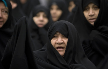 A woman takes part in a demonstration in support of Iranian President Ahmadinejad in Tehran
