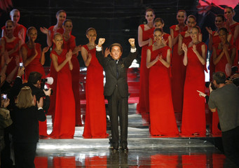 Italian designer Valentino waves at the end of his final Spring/Summer 2008 Haute Couture fashion collection in Paris