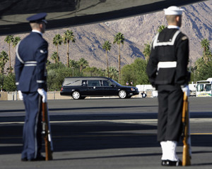 The hearse carrying the coffin of former U.S. President Gerald R. Ford's body arrives at Palm Springs International airport in Palm Springs
