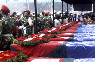 BANGLADESHI MOURNERS LOOK AT THE COFFINS OF 15 ARMY OFFICERS KILLED IN BENING PLANE CRASH.