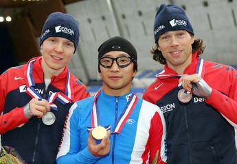 Dutch skaters silver medalist Beorn Nijenhuis (L) and bronze medalist Gerard van Velde (R) celebrate..