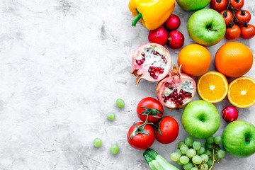 cooking salad with fresh fruits and vegetables on stone background top view mock-up Wall mural