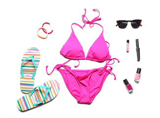 Swimsuit and different accessories on white background