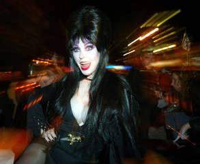 Elvira leads the annual Halloween Day parade along Sixth Avenue in New York, October 31, 2002.  Hall..