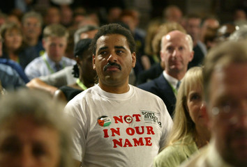 AN ANTI-WAR DELEGATE LISTENS TO BRITISH PRIME MINISTER TONY BLAIRADDRESSES THE TUC CONFERENCE AT BLACKPOOL.