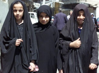 IRAQI GIRLS HEAD FOR A MOSQUE FOR PRAYERS IN BAGHDAD.