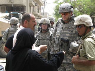 Lieutenant-General Odierno talks to residents at scene of recent car bombing in Baghdad's central Karrada district