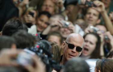 """U.S. actor Bruce Willis arrives at the red carpet for the German premiere of the movie """"Die Hard 4.0"""" in Berlin"""