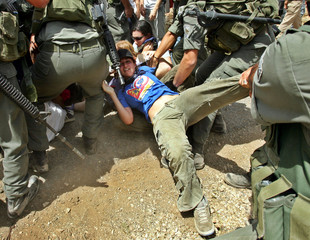 Israeli forces try to arrest a protester during a joint protest with Israelis and Palestinians in Bilin.