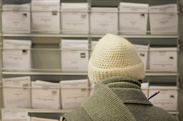 A woman looks for ballot slips at a polling station in Burgos
