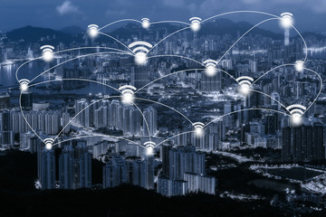 Wifi network connection concept on blue tone Hong Kong cityscape background and network connection concept - Network business conection system