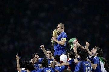 Italy's Fabio Cannavaro kisses the World Cup Trophy after the World Cup 2006 final soccer match between Italy and France in Berlin