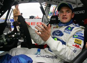 Dani Sola of Spain talks to his mechanics during the service park of the first leg of the 2005 World Championship Catalunya Rally in Salou near Tarragona