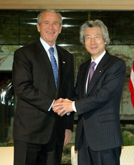 US President Bush shakes hands with Japan's Prime Minister Koizumi at the Kyoto State Guesthouse