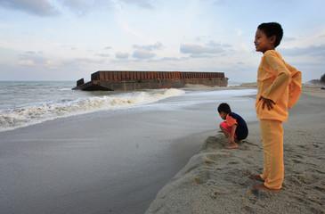 Malaysian children play at a beach in Kuala Terengganu
