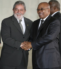 Brazil's President Lula and South Africa's President Zuma shake hands before a meeting at the Itamaraty Palace in Brasília