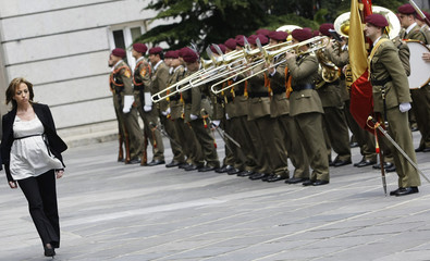 Spain's first female Defence Minister Chacon reviews an honour guard during a ceremony in Madrid