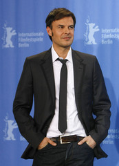 Director Ozon poses during a photocall to promote the movie 'Ricky' of the 59th Berlinale film festival in Berlin