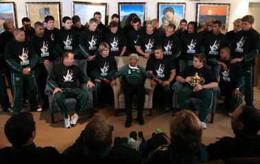 Former South African president Mandela talks to the world cup winning team in Houghton
