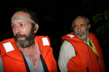 Russo and Arena stand next to each other shortly before they were freed in the Niger Delta
