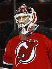 New Jersey Devils goaltender Martin Brodeur looks on during warm up before his team's NHL hockey game against the Montreal Canadiens in Montreal