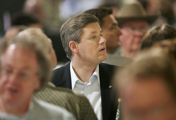 Conservative leader Stephen Harper watches delegates vote during party convention in Montreal.